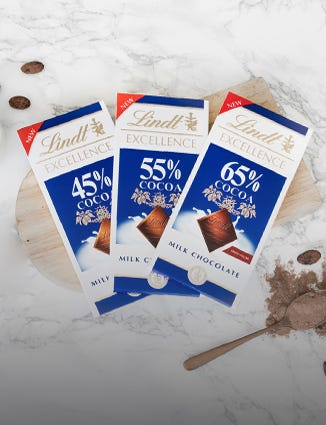 Three bars of Lindt Excellence High Cocoa Milk Chocolate in 45 percent, 55 percent and 65 percent.