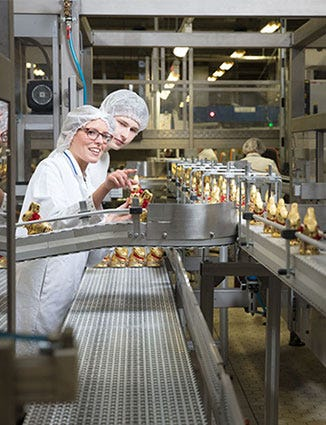 Lindt employees creating the gold bunny.
