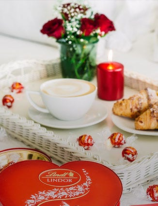 Celebration champagne with flowers and Lindor.
