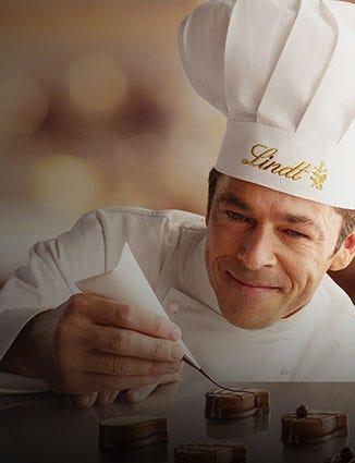 Master Chocolatier decorating truffles.